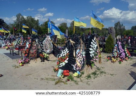 MAY27,2015 in KIEV,UKRAINE .Lesnoye (Forest) Cemetery.Graves of Ukrainan army and nationalist formations soldiers died during Ukrainian Civil War 2014-16 at Donbas. At May 23,2015 in Kiev,Ukraine - stock photo