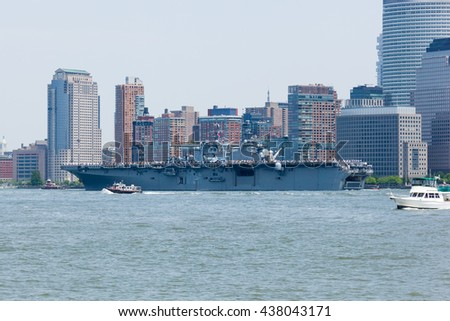 MAY 25, 2016 - Jersey City, NJ:  The USS Bataan Aircraft Carrier travels the Hudson River between Jersey City and Manhattan during the Parade of Ships for Fleet Week, 2016.