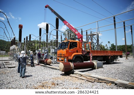 MAY 28, 2015 : KHANORM, THAILAND. Maintenance of electric power main equipment at switchgear, southern region of Thailand.