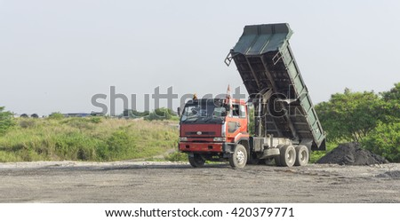 May 14, 2016 - Kuala Lumpur, Malaysia : A close-up of lorry on a construction site against blue sky. - stock photo