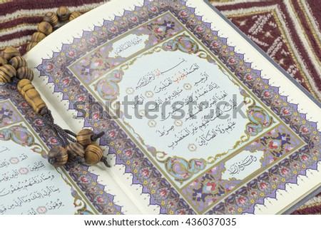May,2016-Kuala Lumpur, Malaysia : A closeup of Holy Quran verse and Tasbih. Holy Quran is book of guidance for Islam.