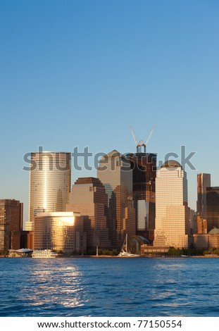 May 2011. Manhattan, lower New York financial offices(downtown) over Hudson river panorama from Jersey city. One World Trade Center building under construction - stock photo