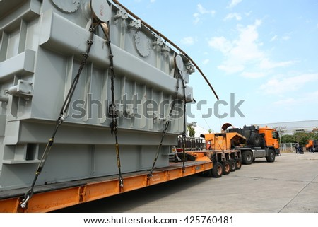 MAY 16, 2016 : NAKHON SAWAN - THAILAND : Under loading heavy power transformer with heavy truck at site to be installed in high voltage station.