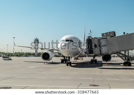 May 31, 2015.Saint Petersburg.Russia. Plane with boarding ramp at the airport Pulkovo. - stock photo