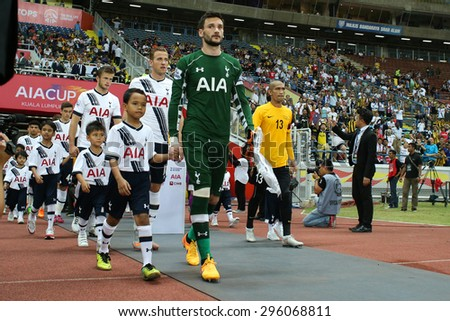 May 27, 2015 - Shah Alam, Malaysia: Tottenham Hotspur's captain Hugo Lloris (green jersey) leads his team out into the field in a friendly match. Tottenham Hotspur is on a Asia-Australia tour. - stock photo