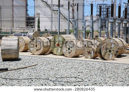 MAY 21, 2015: SRIRACHA, THAILAND. View of new construction of electrical power switchgear with concrete work and equipment installation on bright blue sky and a sunny day.