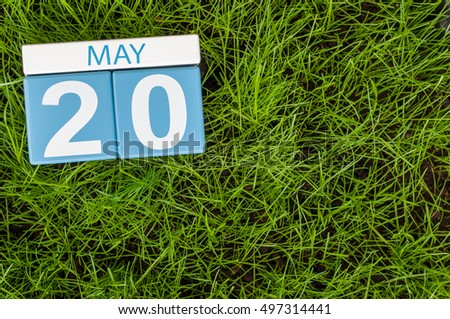 May 20th. Day 20 of month, calendar on football green grass background. Spring time, empty space for text