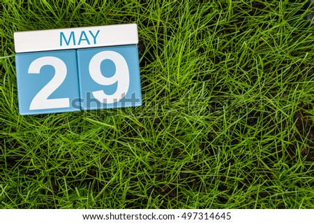 May 29th. Day 29 of month, calendar on football green grass background. Spring time, empty space for text