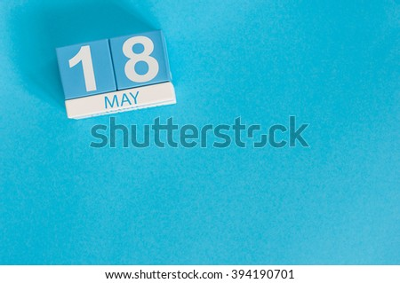 May 18th. Image of may 18 wooden color calendar on blue background.  Spring day, empty space for text.  International Museum Day - stock photo