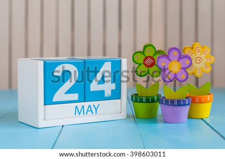 May 24th. Image of may 24 wooden color calendar on white background with flowers. Spring day, empty space for text. The European Day Of Parks, EDoP - stock photo