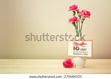 May 10th Mothers Day card with pink carnations - stock photo