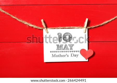 May 10th Mothers Day card with small red heart hanging with clothespins - stock photo