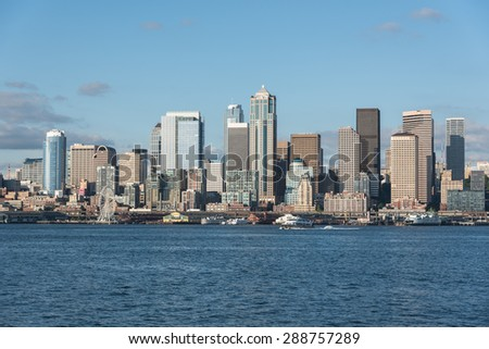 MAY 15th 2015, SEATTLE: A view of Seattle downtown, skyscraper, business district and blue ocean from Alki Beach, Seattle WA - stock photo