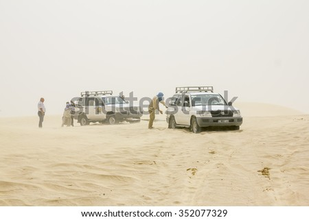 May 20, 2013. The caravan of cars stuck in the Sahara desert in a sandstorm.Tunisia. - stock photo