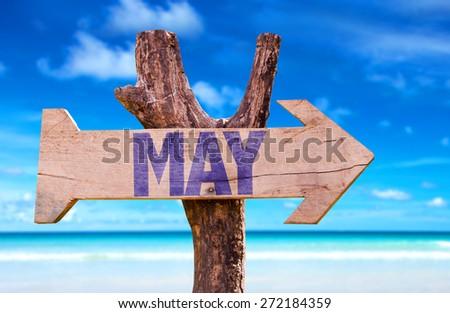 May wooden sign with beach background - stock photo