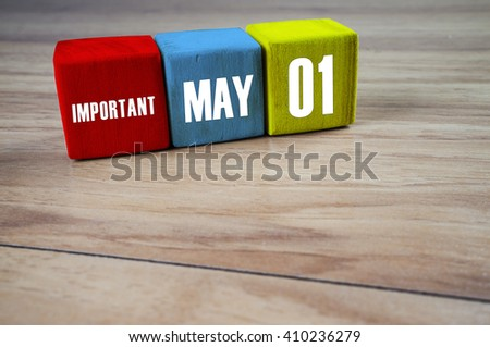 May 01 written on a wooden block to remind you an important appointment