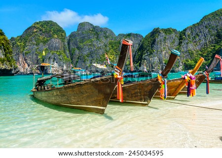 Maya Bay is a stunningly beautiful bay that's sheltered by 100-metre high cliffs on three sides with several beaches with soft white sand, underwater colourful coral and exotic fish in clear water. - stock photo