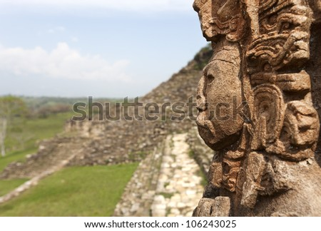maya ruins in jungle, portrait of the God, Tonina in Mexico - stock photo