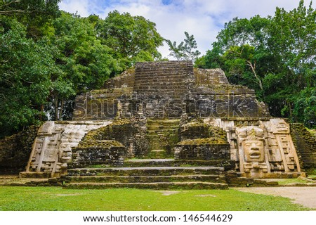 Maya temple in the rain forest - stock photo