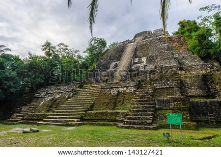 Maya temple in the rain forest of Xunantunich - stock photo