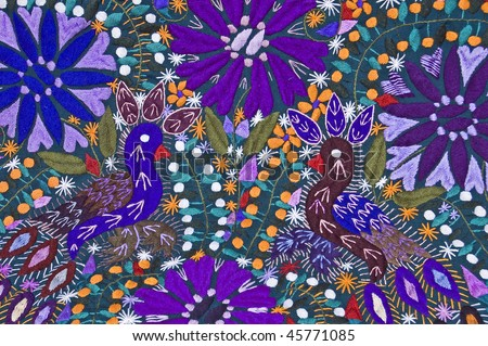 Mayan blanket showing flowers and peacocks - stock photo