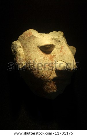 Mayan mask with long nose - stock photo