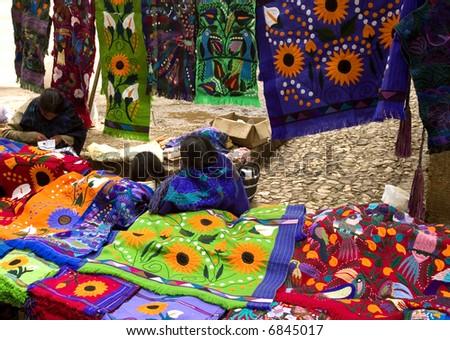 Mayan people selling shirts - stock photo