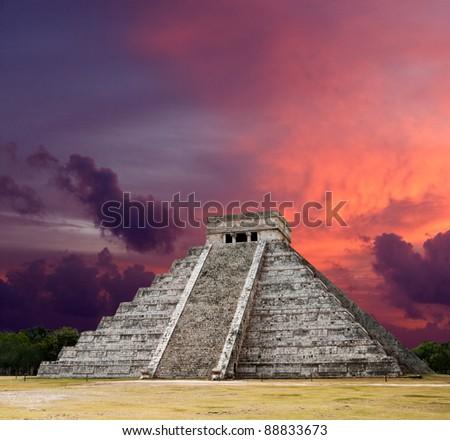 Mayan pyramid of Kukulcan El Castillo on sunset. Chichen-Itza, Mexico - stock photo