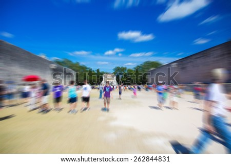 Mayan Ruin, the Pyramid - Chichen Itza Mexico, people walking around, radial blurred filter applied  - stock photo