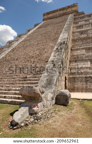 Mayan temple stairs with sculpted snake head in the foreground - stock photo