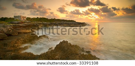 Mayan temple structure at sunrise on the in Mexico. - stock photo