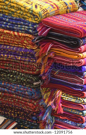Mayan Textiles in a stack sold in mexican market - stock photo