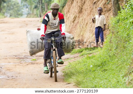 MAYANGE; RWANDA - NOVEMBER 4: Unidentified boys in a dusty road at November 4; 2013. - stock photo
