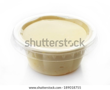 Mayonnaise in a plastic take away container isolated on white - stock photo