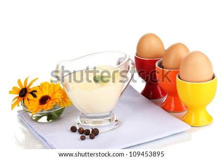Mayonnaise in bowl on napkin isolated on white