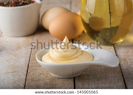 Mayonnaise in bowl  on table. Selective focus. - stock photo