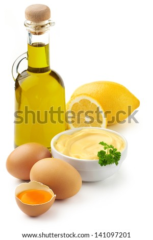 mayonnaise ingredients: olive oil, eggs and lemon - stock photo