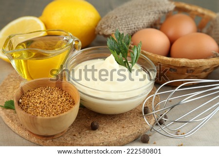 Mayonnaise ingredients on wooden background - stock photo
