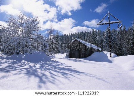 Maypole by a hut in the winter, Sweden - stock photo