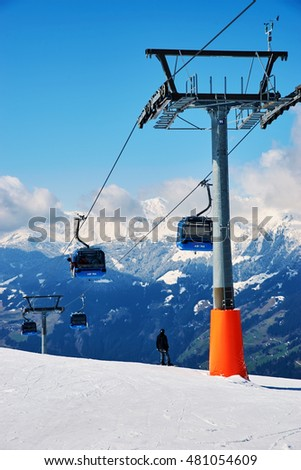 MAYRHOFEN, AUSTRIA - MARCH 28, 2015 - Slopes and ski lifts at alpine skiing resort at Mayrhofen, Austria on March 28, 2015