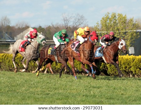 MAYS LANDING, NJ- April 23: Atlantic City Race Coarse in their second day of live racing of the season. Jockey with horses coming down home stretch, in Mays Landing NJ. April 23, 2009. - stock photo
