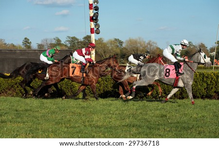 MAYS LANDING, NJ- APRIL 23: Atlantic City Race Coarse in their second day of live racing of the season April 23,2009 in Mays Landing. Jockeys with their horses coming across the finish line. - stock photo