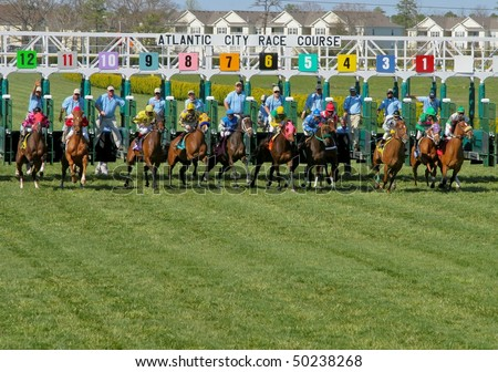 MAYS LANDING, NJ - APRIL 23: Jockeys with their horses come down the home stretch April 23, 2009 in Mays Landing, NJ. - stock photo