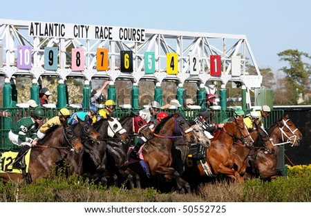 MAYS LANDING, NJ - APRIL 23: Jockeys with their horses  leave the gate  at the Atlantic City Racetrack April 23, 2009 in Mays Landing, NJ. - stock photo