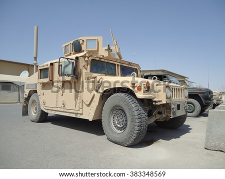 "MAZAR E SHARIF / AFGHANISTAN - AUGUST 2010: american army transporter "" HMMWV, humvee "" in mazar-i-sharif at august 2010."