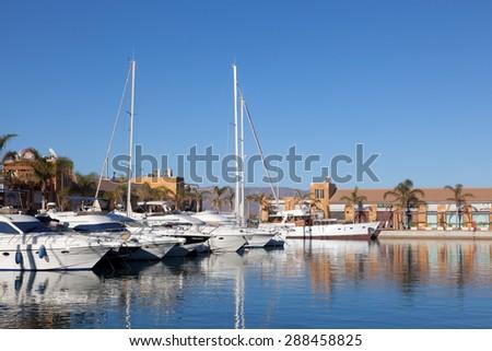 MAZARRON, SPAIN - MAY 17: Luxury yachts and motorboats in the marina of Puerto de Mazarron. May 17, 2015 in Mazarron, Spain - stock photo