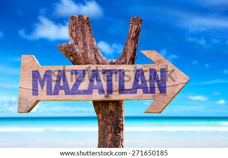 Mazatlan wooden sign with beach background - stock photo