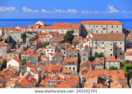 Maze of orange roof tiles and distant Adriatic sea near the old town of Dubrovnik, Croatia - stock photo