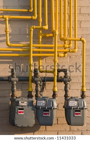 Maze of pipes and natural gas meters. Concept for raising energy or utility costs, environmental concerns or advantages of alternative heating methods. - stock photo