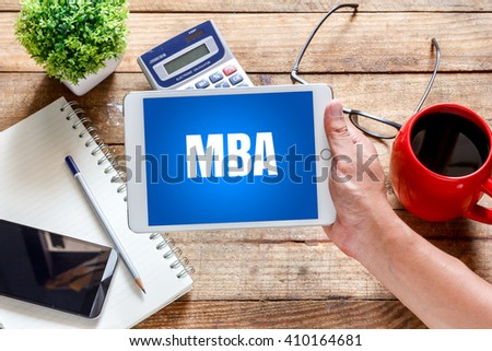 MBA  concept.Tablet with MBA inside Like on the table with offee. - stock photo